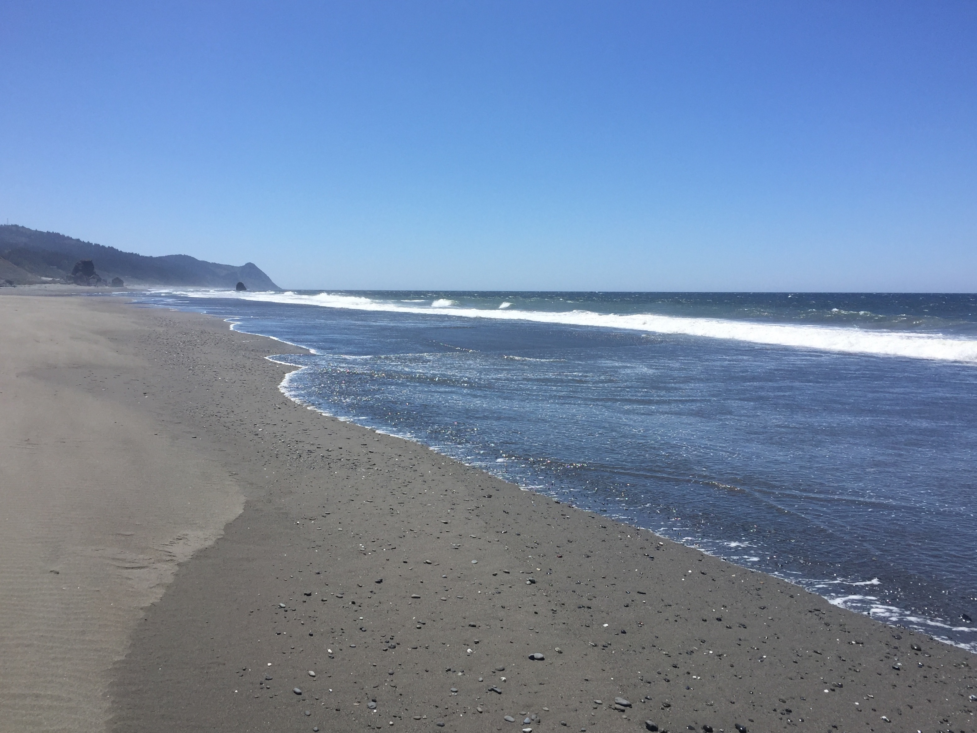 waves and sand at gold beach oregon